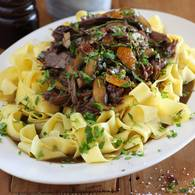 Beef shin with pappardelle roasted garlic and parsley