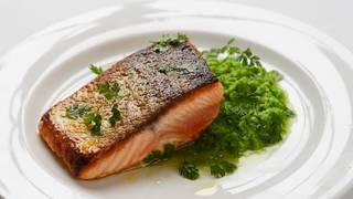 Crispy skin salmon with pea puree