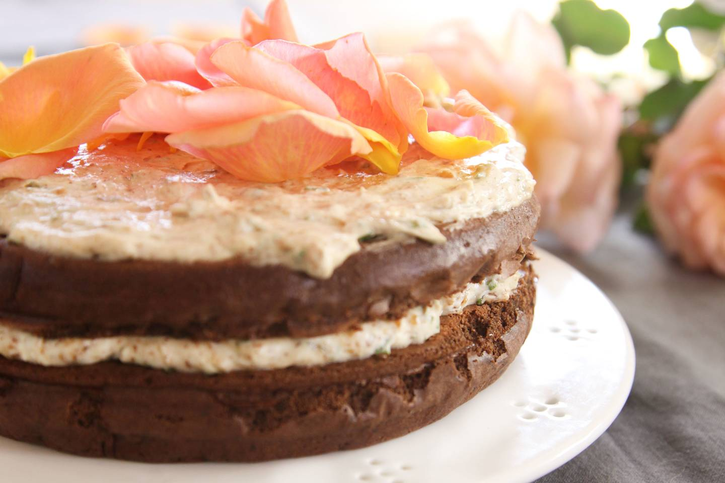 Chocolate cloud cake with nut cream and rose petals