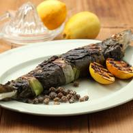 Fish wrapped in vine leaves
