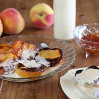 Poached peaches with marmalade sabayon